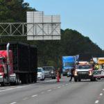 CBRNe - Tanker hauling hazmat crashes into police car, catches fire on I-12; 2 injured