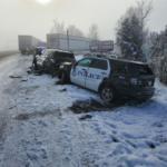 Trucks strike Klamath Fall police cars, fire truck on Highway 97
